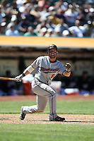 OAKLAND, CA - JUNE 6:  Nick Punto #8 of the Minnesota Twins grimaces while batting during the game against the Oakland Athletics at the Oakland-Alameda County Coliseum on June 6, 2010 in Oakland, California. Photo by Brad Mangin