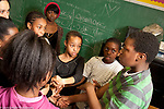 Elementary School afterschool program social emotional learning affirmation trust exercise for group of students, adults guiding process