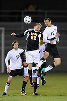 Dave Vaeth (22) of the UMBC Retrievers and Josh Walburn (15) of the Princeton Tigers go up for a header. UMBC Retrievers defeated Princeton Tigers 2-1 during the first round of the 2010 NCAA Division 1 Men's Soccer Championship at Roberts Stadium in Princeton, NJ, on November 18, 2010.