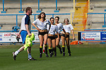 FC Halifax Town 1 Mickleover Sports 1, 23/04/2011. The Shay, Northern Premier League. A member of the coaching staff walking past a group of cheerleaders on the pitch at The Shay, home of FC Halifax Town, on the day that they were presented with the Northern Premier League Premier Division championship trophy following their match with Mickleover Sports. The club replaced Halifax Town A.F.C. who went into administration during the 2007–08 season, having previously been members of the Football League for 80 years. Their promotion meant they would play in Conference North in the 2011-12 season. Photo by Colin McPherson.