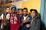 High school students posing in corridor between classes