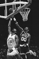 OAKLAND, CA - Robert Parrish (right) of the Boston Celtics in action against Ralph Sampson of the Golden State Warriors during a game at the Oakland Coliseum Arena in Oakland, California in 1988. Photo by Brad Mangin