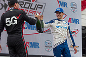 Race winner #10: Alex Palou, Chip Ganassi Racing Honda celebrates with #12: Will Power, Team Penske Chevrolet