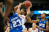 NORFOLK, VA--Amber Orrange drives through traffic against Hampton University at the Ted Constant Convocation Center at Old Dominion University in Norfolk, VA in the first round of the 2012 NCAA Championships. The Cardinal advanced with a 73-51 win to play West Virginia on Monday, March 19.