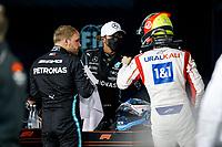 28th March 2021; Sakhir, Bahrain; F1 Grand Prix of Bahrain, Race Day;   HAMILTON Lewis gbr, Mercedes AMG F1 GP W12 E Performance is congratulated by SCHUMACHER Mick ger, Haas F1 Team VF-21 Ferrari, after winning the Formula 1 Gulf Air Bahrain Grand Prix 2021