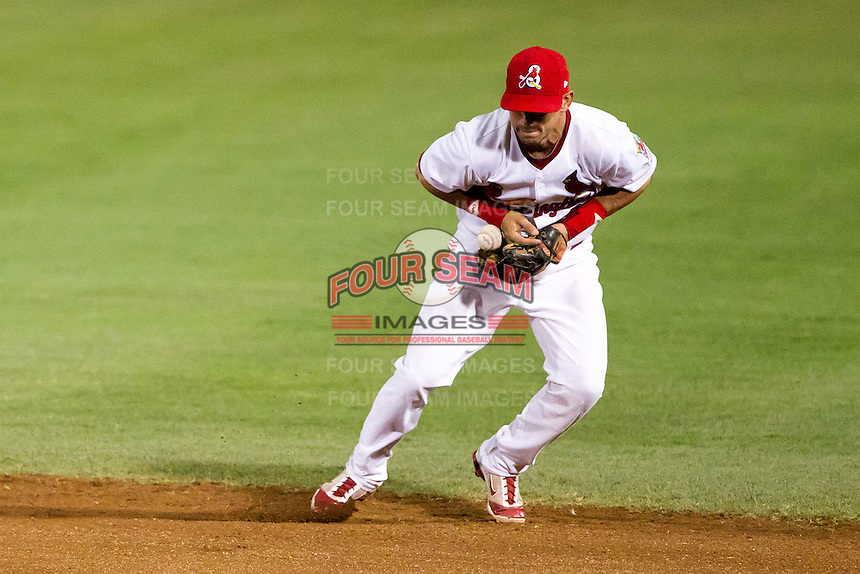 Jose Garcia (3) of the Springfield Cardinals loses his grip on the ball during a game against the Tulsa Drillers at Hammons Field on July 20, 2011 in Springfield, Missouri. Springfield defeated Tulsa 12-1. (David Welker / Four Seam Images)
