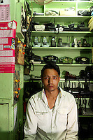 A man sits in second-hand telephone market in the Chandni Chowk electronics market in Kolkata.<br /> <br /> To license this image, please contact the National Geographic Creative Collection:<br /> <br /> Image ID: 1925746 <br />  <br /> Email: natgeocreative@ngs.org<br /> <br /> Telephone: 202 857 7537 / Toll Free 800 434 2244<br /> <br /> National Geographic Creative<br /> 1145 17th St NW, Washington DC 20036
