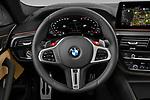Car pictures of steering wheel view of a 2021 BMW M5 Competition 4 Door Sedan Steering Wheel
