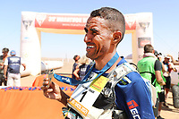 8th October 2021; Boulchrhal to Sud Jebel Irhfelt N'Tissalt ;  Marathon des Sables, stage 5 and final stage of  a six-day, 251 km ultramarathon, which is approximately the distance of six regular marathons. The longest single stage is 91 km long. This multiday race is held every year in southern Morocco, in the Sahara Desert. Rachid El Morabity shows off his winners medal