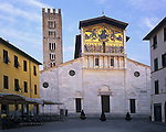 Tuscany, Italy<br /> Morning light on the facade of the church San Frediano (1200) and piazza in the center of Lucca
