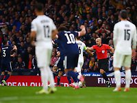 9th October 2021; Hampden Park, Glasgow, Scotland; FIFA World Cup football qualification, Scotland versus Israel;  Referee performs a VAR check after initially ruling out Lyndon Dykes of Scotland goal in the 57th minute that made it 2-2 and overrules and gives the goal