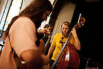 September 14, 2010.  Durham, North Carolina.. Brad Cook, right, warms up on the standup bass.. Day One of Sounds of the South, a reinterpretation of Alan Lomax's field recordings, with music by Megafaun, Fight the Big Bull, Sharon Van Etten and Justin Vernon of Bon Iver..
