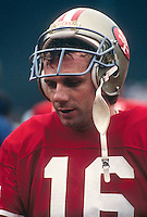 SAN FRANCISCO, CA - Joe Montana of the San Francisco 49ers on the sidelines during a game at Candlestick Park in San Francisco, California in 1987.  Photo by Brad Mangin