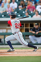 Todd Cunningham (20) of the Gwinnett Braves follows through on his swing against the Charlotte Knights at BB&T BallPark on August 11, 2015 in Charlotte, North Carolina.  The Knights defeated the Braves 3-2.  (Brian Westerholt/Four Seam Images)