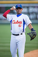 Yordan Manduley Escalona (42) of the Cuban National Team warms up prior to the game against the US Collegiate National Team at BB&T BallPark on July 4, 2015 in Charlotte, North Carolina.  The United State Collegiate National Team defeated the Cuban National Team 11-1.  (Brian Westerholt/Four Seam Images)