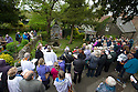 14/05/15<br /> <br /> Hundred of people sing hymns as clergy members bless the V.E. Day inspired design, at Coffin Well - named after the shape of the well.<br /> <br /> To mark ascension day this year's well dressings are unveiled and blessed by the local clergy in the Derbyshire village of Tissington in the Peak District National Park.<br /> <br /> Before today's blessings, wooden boards coated in clay are decorated with tens of thousands of petals, leaves and pieces of foliage to create the giant intricate mosaics. The boards,  take teams of many villagers three days to make. <br /> <br /> The village has been decorating its six wells every year for more than six hundred years. The tradition is believed to be a celebration of the wells never running dry, giving life and  sustaining the village during times of plague. After a church service today (Thursday)  clergy from six parish will bless each of the well.  <br /> <br /> Following in Tissington's footsteps many other villages in the Derbyshire area also have their own well dressing traditions.<br /> <br /> <br /> All Rights Reserved: F Stop Press Ltd. +44(0)1335 418629   www.fstoppress.com.