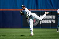 Michigan Wolverines right fielder Christan Bullock (5) throws a baserunner out at home during a game against Army West Point on February 18, 2018 at Tradition Field in St. Lucie, Florida.  Michigan defeated Army 7-3.  (Mike Janes/Four Seam Images)