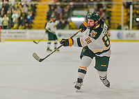 20 February 2016: University of Vermont Catamount Forward Jonathan Turk (right), a Senior from Calgary, Alberta, takes a second period slapshot against the Boston College Eagles at Gutterson Fieldhouse in Burlington, Vermont. The Eagles defeated the Catamounts 4-1 in the second game of their weekend series. Mandatory Credit: Ed Wolfstein Photo *** RAW (NEF) Image File Available ***