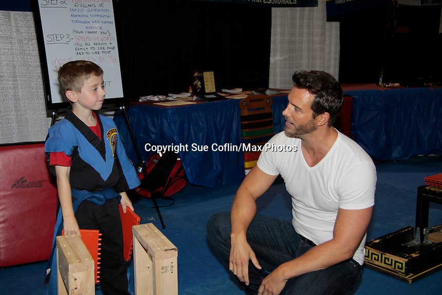 "Days of Our Lives Eric Martsolf ""Brady Black"" appears at the 12th Annual Comcast Women's Expo on September 7 (also 6th), 2014 at the Connecticut Convention Center, Hartford, CT. Eric visited the Villari's Windsor Studio - Martial Arts Centers' booth and broke some boards with Ryan Farley.  (Photo by Sue Coflin/Max Photos)"