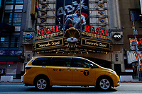 NEW YORK, NEW YORK - MARCH 05: A taxi drives in front a Regal Cinema in Times Square on March 05, 2021, in New York. NY Governor, Andrew Cuomo gave the permission to reopen cinemas on Feb. 22 at 25% capacity, or a maximum of 50 people per show. (Photo by John Smith/VIEWpress)