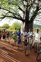 TANZANIA, Kondoa, village of Sandawe tribe, villagers with bicycle under Baobab tree  / TANSANIA, Kondoa, Sandawe Volk, Menschen eines Dorfes mit Fahrrad unter Baobab Baum
