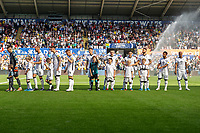 Swansea Mascots with Swansea Players during the Sky Bet Championship match between Swansea City and Nottingham Forest at the Liberty Stadium in Swansea, Wales, UK. Saturday 14 September 2019