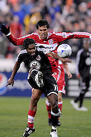 DC United  forward Luciano Emilio (11) tries to control the ball while covered from behind by Chicago Fire defender Wilman Conde. Chicago Fire tied DC United 1-1 at  RFK Stadium, Saturday March 28, 2009.