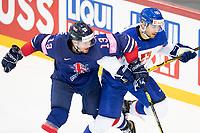 23rd May 2021, Riga Olympic Sports Centre Latvia; 2021 IIHF Ice hockey, Eishockey World Championship, Great Britain versus Slovakia;  13 David Phillips Great Britain and 88 Kristian Pospisil Slovakia hunting the puck.