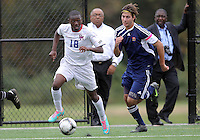 HYATTSVILLE, MD - OCTOBER 26, 2012:  Chris Odoi-Atsem (18) of DeMatha Catholic High School races away from from Camyer Matini (5) of St. Albans during a match at Heurich Field in Hyattsville, MD. on October 26. DeMatha won 2-0.