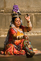 A Rajasthani woman performs a traditional DANCE using metal CYMBALS at the BAGORE KI HAVELI in UDAIPUR - RAJASTHAN, INDIA