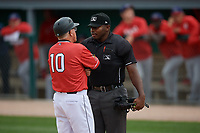 Batavia Muckdogs manager Tom Lawless (10) talks with umpire Tre Jester during a NY-Penn League game against the Auburn Doubledays on September 1, 2019 at Dwyer Stadium in Batavia, New York.  Auburn defeated Batavia 3-1.  (Mike Janes/Four Seam Images)
