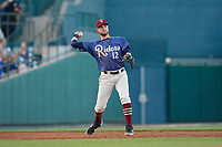 Frisco RoughRiders Charles Leblanc (12) throws to first base during a Texas League game against the Springfield Cardinals on May 4, 2019 at Dr Pepper Ballpark in Frisco, Texas.  (Mike Augustin/Four Seam Images)