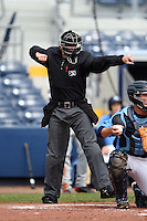 Home plate umpire Blake Carnahan makes a call during a game between the Fort Myers Miracle and Charlotte Stone Crabs on April 16, 2014 at Charlotte Sports Park in Port Charlotte, Florida.  Fort Myers defeated Charlotte 6-5.  (Mike Janes/Four Seam Images)