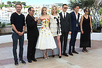 Editor Matthew Newman, composer Cliff Martinez, actors Bella Heathcote, Elle Fanning, director Nicolas Winding Refn, actor Karl Glusman and producer Lene Borglum attends 'The Neon Demon' Photocall durig The 69th Annual Cannes Film Festival on May 20, 2016 in Cannes