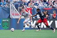 FOXBOROUGH, MA - JULY 25: Djordje Mihailovic #8 of CF Montreal brings the ball forward during a game between CF Montreal and New England Revolution at Gillette Stadium on July 25, 2021 in Foxborough, Massachusetts.