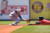 Tennessee Smokies second baseman Stephen Bruno (11) waits for a throw as Micah Johnson (2) slides in during a game against the Birmingham Barons on April 21, 2014 at Regions Field in Birmingham, Alabama.  Tennessee defeated Birmingham 10-5.  (Mike Janes/Four Seam Images)