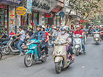 The motorbike is a major means of transportation in Hanoi today. In a city with a population of about 8 million, there are said to be about 4 million motorbikes in operation. On the streets there is a constant flow of them.
