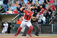 Rochester Red Wings catcher Eric Fryer (19) looks for a pop up in front of umpire Brad Myers during an International League playoff game against the Pawtucket Red Sox on September 5, 2013 at Frontier Field in Rochester, New York.  Pawtucket defeated Rochester 7-2.  (Mike Janes/Four Seam Images)