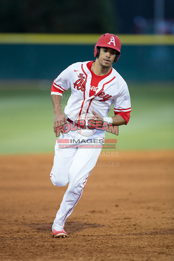 Kayden Krause (13) of the Belmont Abbey Crusaders rounds the bases during the game against the Catawba Indians at Abbey Yard on February 7, 2017 in Belmont, North Carolina.  The Crusaders defeated the Indians 12-9.  (Brian Westerholt/Four Seam Images)