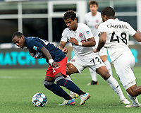 FOXBOROUGH, MA - JULY 23: Michel #48 of New England Revolution II dribbles as Steffen Yeates #72 of Toronto FC II defends during a game between Toronto FC II and New England Revolution II at Gillette Stadium on July 23, 2021 in Foxborough, Massachusetts.