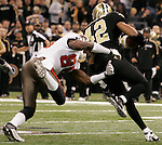 December 2009: New Orleans Saints safety Darren Sharper (42) runs with the ball after an interception during an NFL football game at the Louisiana Superdome in New Orleans.