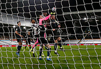 13th March 2021, Craven Cottage, London, England;  Manchester Citys goalkeeper Ederson punches the ball clear from his goal during the English Premier League match between Fulham and Manchester City at Craven Cottage in London
