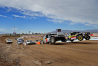 Nov. 6, 2010; Las Vegas, NV USA; LOORRS pro four unlimited drivers Kyle Leduc (99) and Mike Johnson (31) lead the field to the green flag during round 13 at the Las Vegas Motor Speedway short course. Mandatory Credit: Mark J. Rebilas-