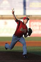 Branden Shipley #14 of the Visalia Rawhide pitches against the High Desert Mavericks at Heritage Field on July 19, 2014 in Adelanto, California. Visalia defeated High Desert, 10-9. (Larry Goren/Four Seam Images)