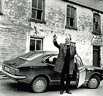 Bishop Eamon Casey pictured with his sports car outside his family home in Firies, about 9 miles from Killarney. Photo: macmonagle.com archive