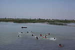 AL-SELKHA, IRAQ: A group of boys go swimming in the waterways around the village of Al Selkha...Dozens of families displaced by years of violence live in the village of Al Selkha in Nasiriya...Photo by Ali Arkady/Metrography