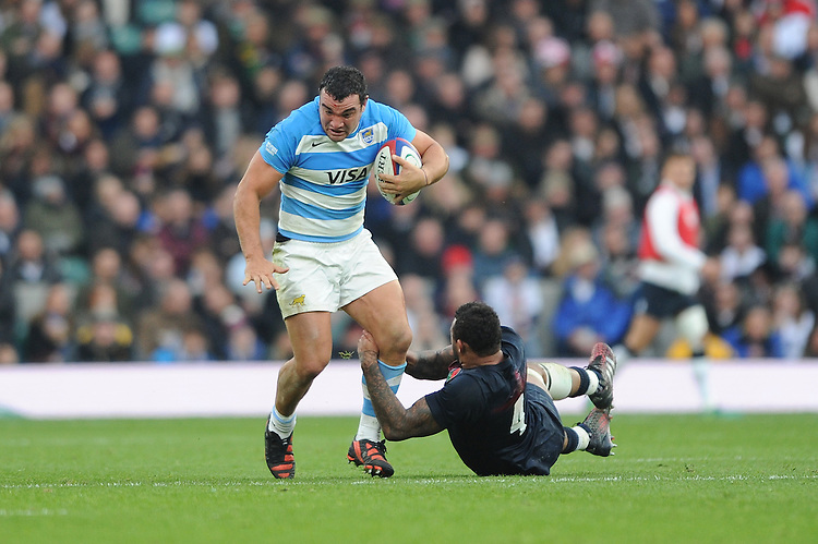 Agustín Creevy of Argentina shrugs off Courtney Lawes of England during the Old Mutual Wealth Series match between England and Argentina at Twickenham Stadium on Saturday 26th November 2016 (Photo by Rob Munro)