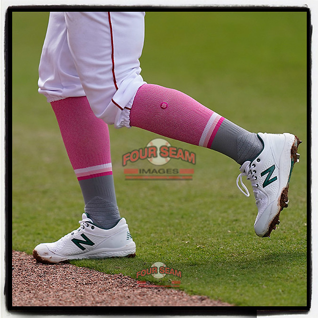 Cam Cannon (4) of the Greenville Drive wore pink socks in a game against the Bowling Green Hot Rods on Mother's Day, Sunday, May 9, 2021, at Fluor Field at the West End in Greenville, South Carolina. (Tom Priddy/Four Seam Images)