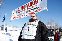 2009 Junior Iditarod Ola Williams poses at the finish line in Willow.  Ola has been volunteering as a communications specialist for 9 years.