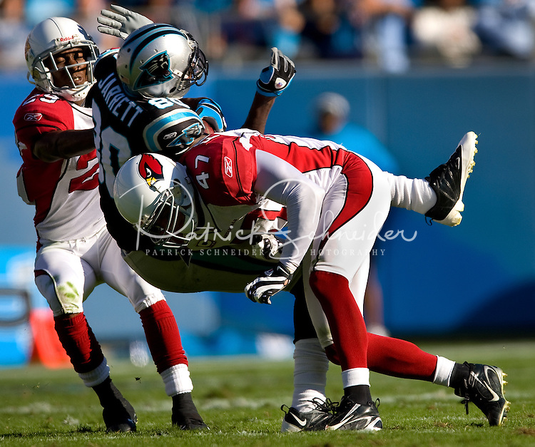 Carolina Panthers wide receiver Dwayne Jarrett (80) is hit by Arizona Cardinals safety Aaron Francisco (47) during an NFL football game at Bank of America Stadium in Charlotte, NC.